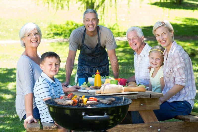 Happy family having picnic in the park royalty free stock photos