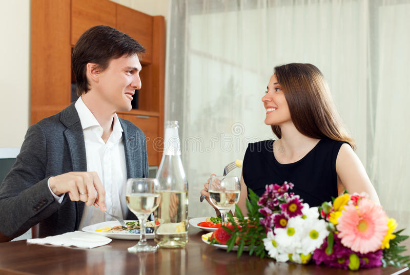 Happy family having romantic dinner and celebration. Valentine day in home stock photography