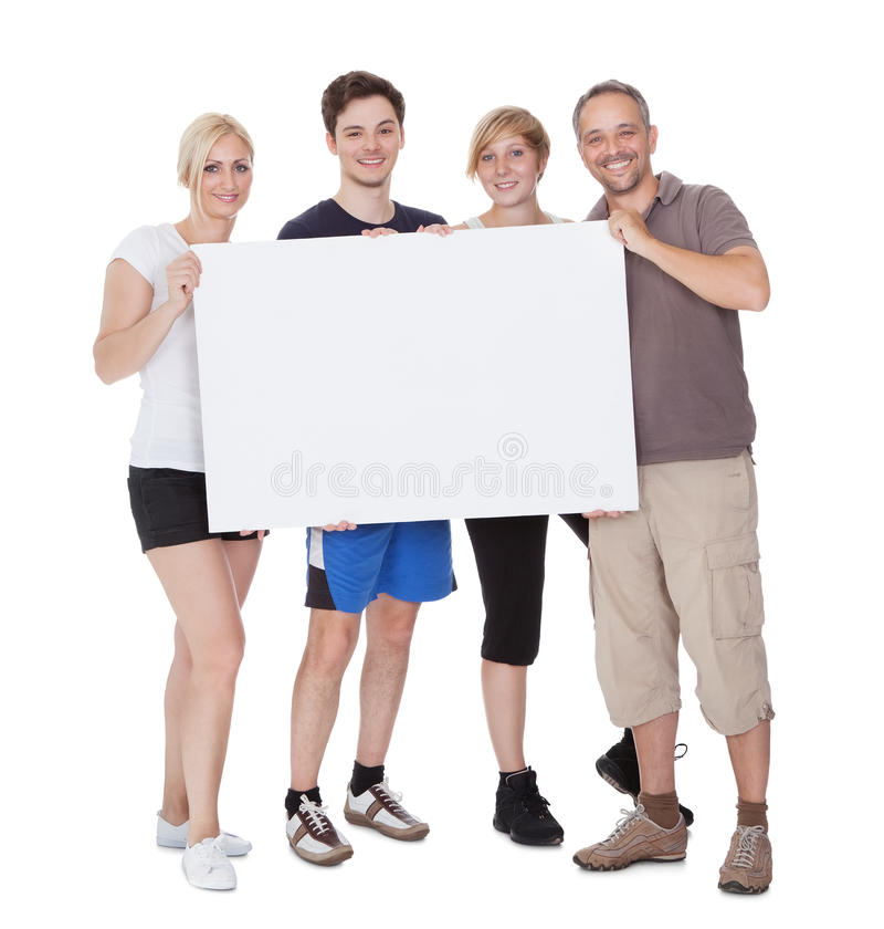 Free Happy Family Holding Blank Placard Royalty Free Stock Images - 27924239
