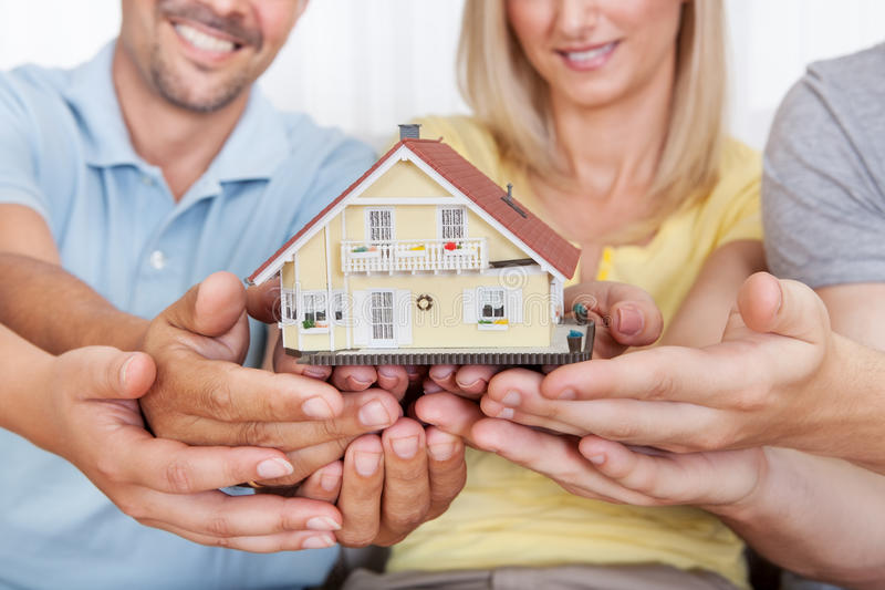 Download Happy Family Holding A Model House Stock Photo - Image: 27924194
