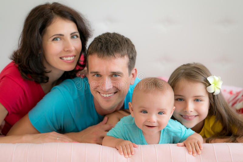 Happy family at home stock photos