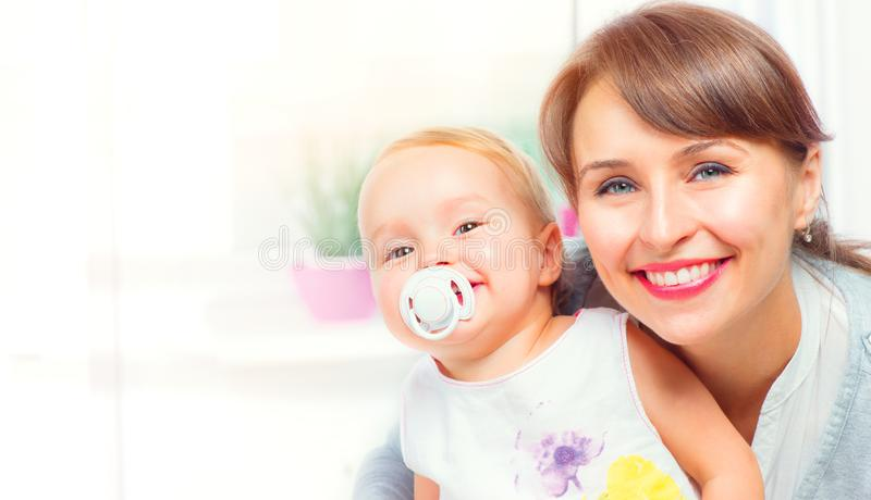 Happy family at home. Mother and her little daughter together. Maternity concept stock photos
