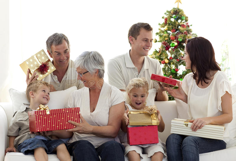Download Happy Family At Home Opening Christmas Presents Stock Photo - Image: 11583948