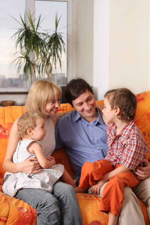Happy family of the house on a sofa royalty free stock photography