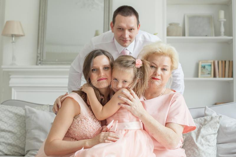 Happy family hugging. Grandmother and mother royalty free stock image