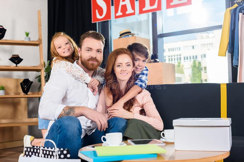 happy family hugging and resting on sofa in boutique stock images