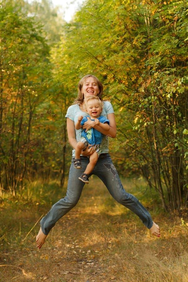 Happy family jump stock image