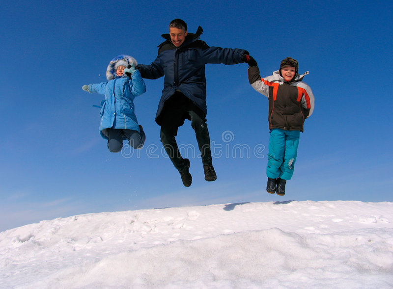 Happy family jumping stock image