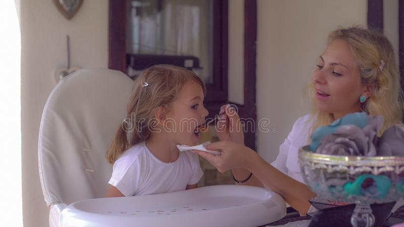 Happy family with kid enjoy lunch. royalty free stock photography