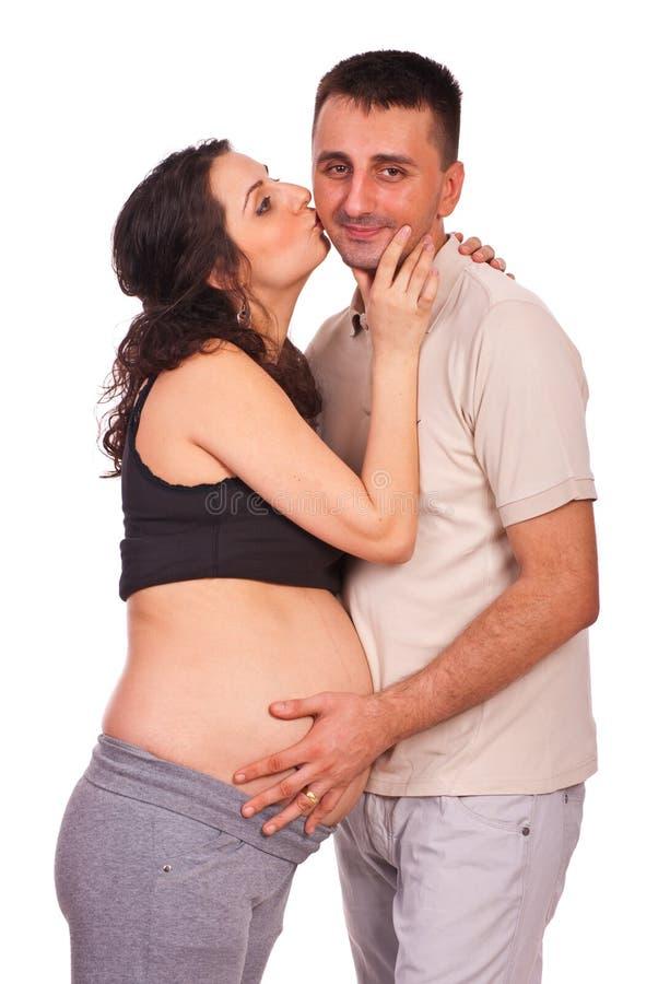 Happy family kissing stock photos
