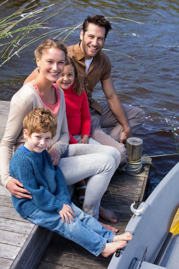 Happy family at a lake stock photo