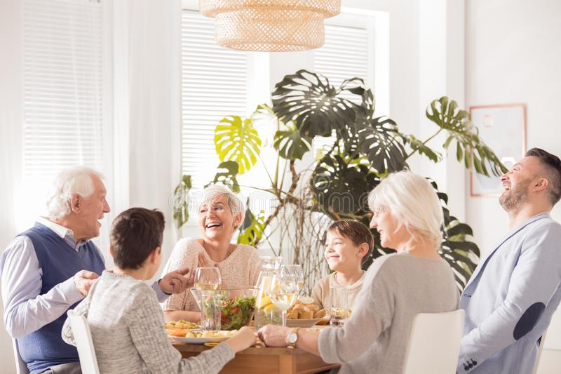 Happy family laughing. Happy family spending time together and laughing royalty free stock image