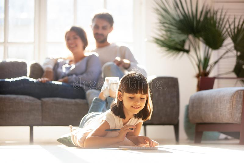 Happy family with little daughter spending free time at home stock images