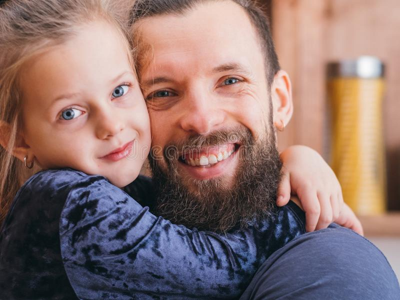 Happy family little girl hugging dear father love stock photography