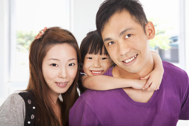 Happy family with little girl stock image
