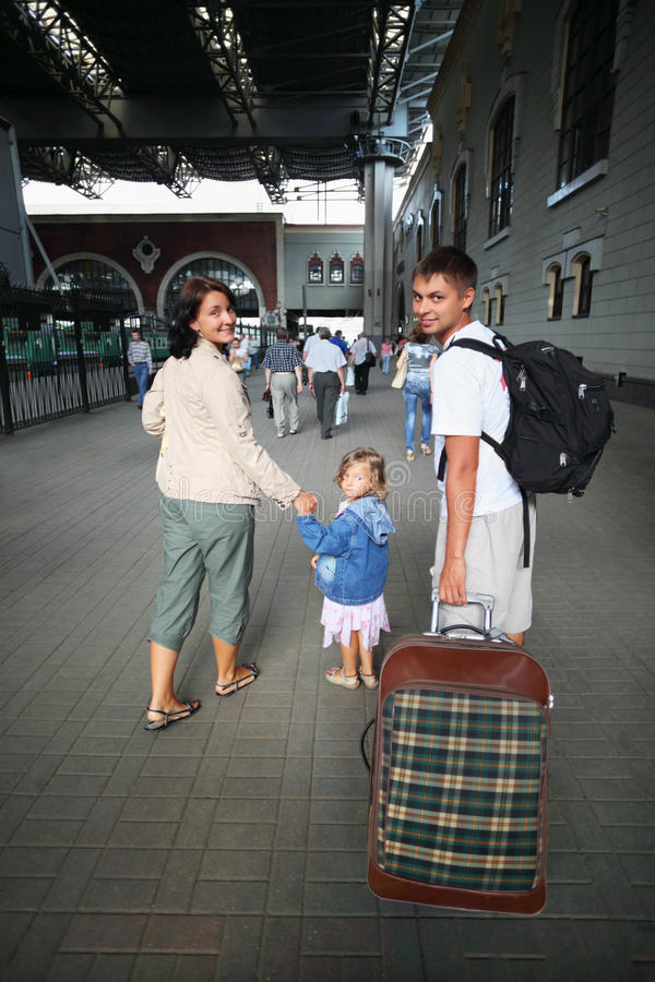 Happy family with little girl at railway station royalty free stock images