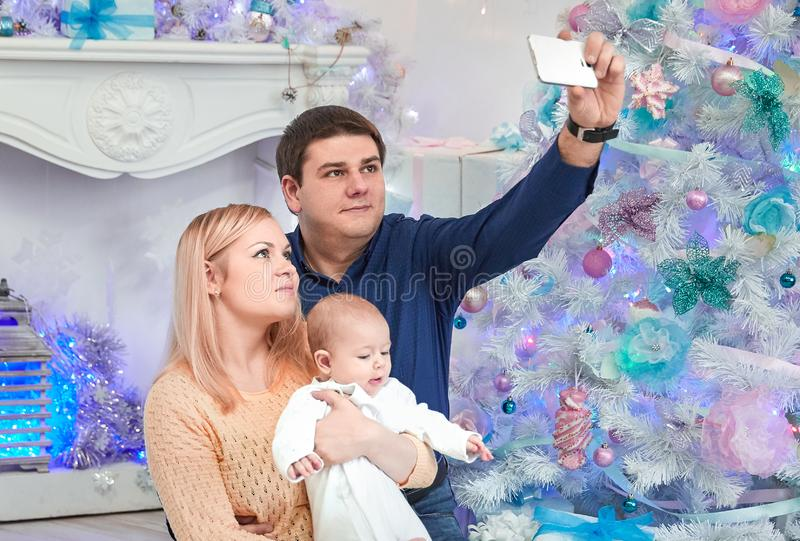 Happy family looking at a blank Christmas card. royalty free stock image