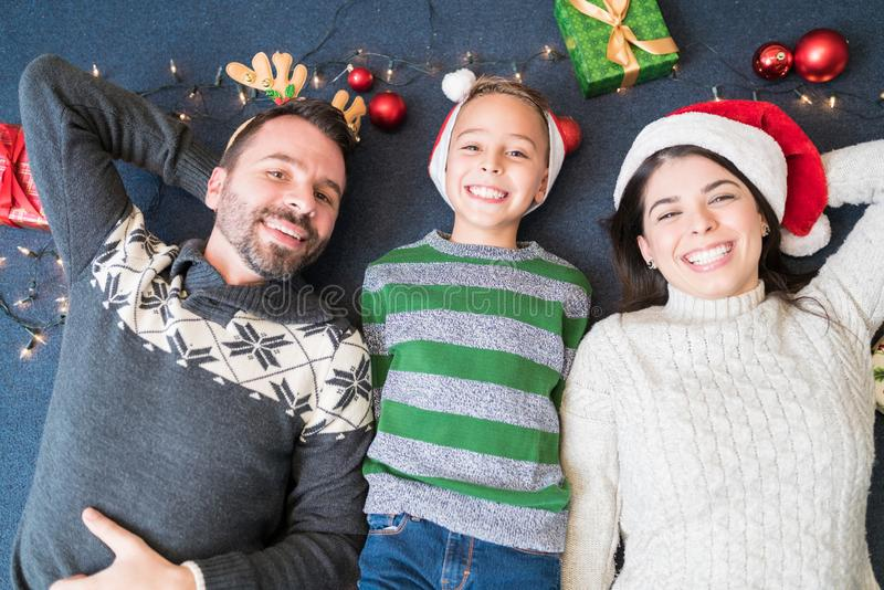 Happy Family Lying On Decorated Carpet At Home stock photos