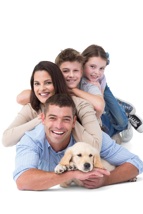 Free Happy Family Lying On Top Of Each Other With Dog Stock Image - 50493031
