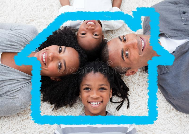 Happy family lying on rug overlaid with house shape. Digital composition of happy family lying on rug overlaid with house shape stock image