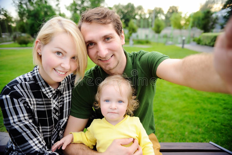 Happy family making selfie photo together. Young beautiful happy family making selfie photo together stock photo
