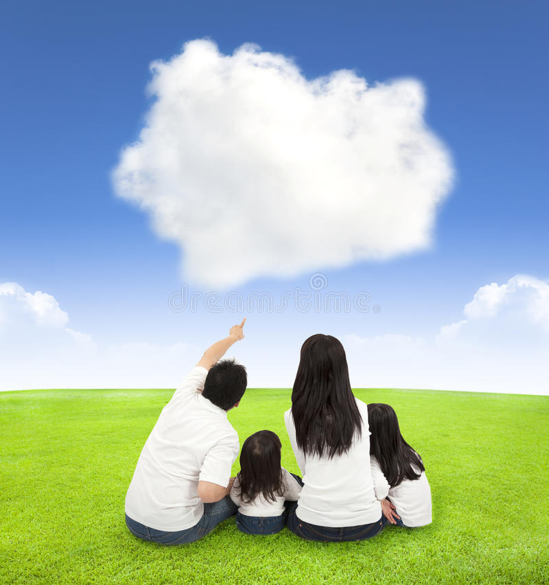 Happy family on a meadow with cloud background stock photography