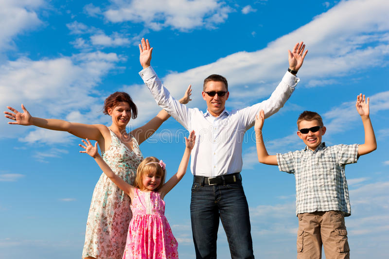 Download Happy Family On A Meadow In Summer Stock Photo - Image: 20283516