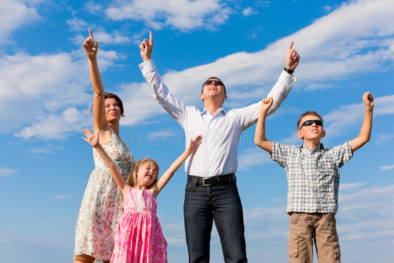 Download Happy Family On A Meadow In Summer Stock Photo - Image: 24456472
