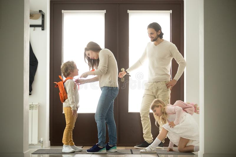 Happy family morning preparations, parents getting kids ready fo stock photo