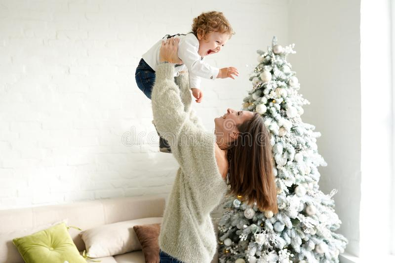 Happy family mother and baby boy playing in the winter for the Christmas holidays stock photography