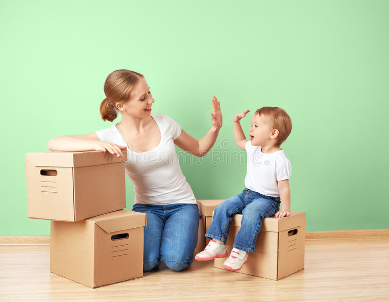 Happy family mother and baby daughter in an empty apartment with royalty free stock images