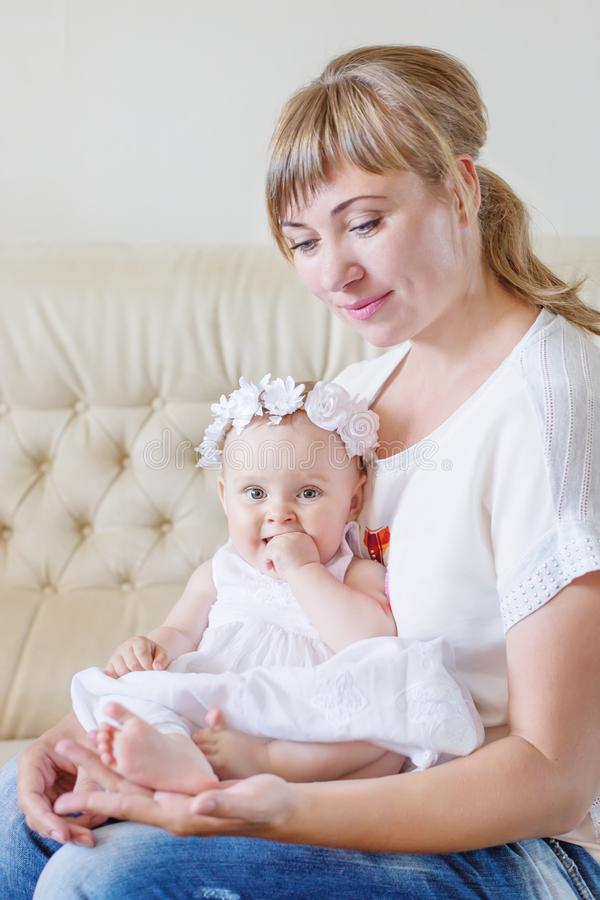 Happy family. Mother and baby daughter plays royalty free stock photos