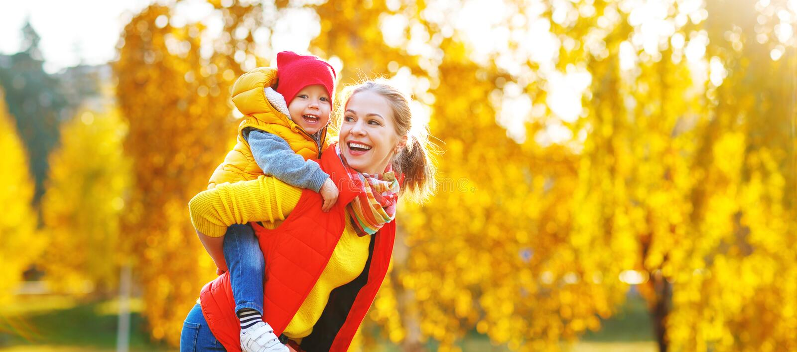 Happy family mother and baby son on autumn walk. Happy family mother and baby son playing and laughing on autumn walk royalty free stock photography