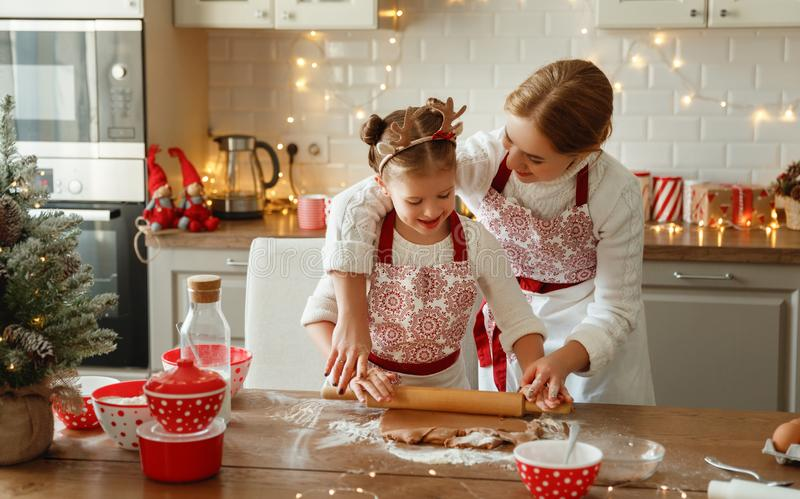 Happy family mother and child bake christmas cookies royalty free stock images
