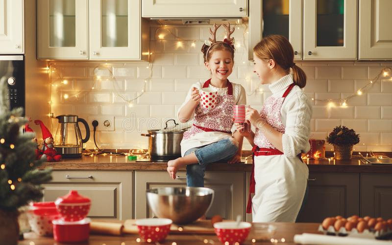 Happy family mother and child bake christmas cookies stock photos