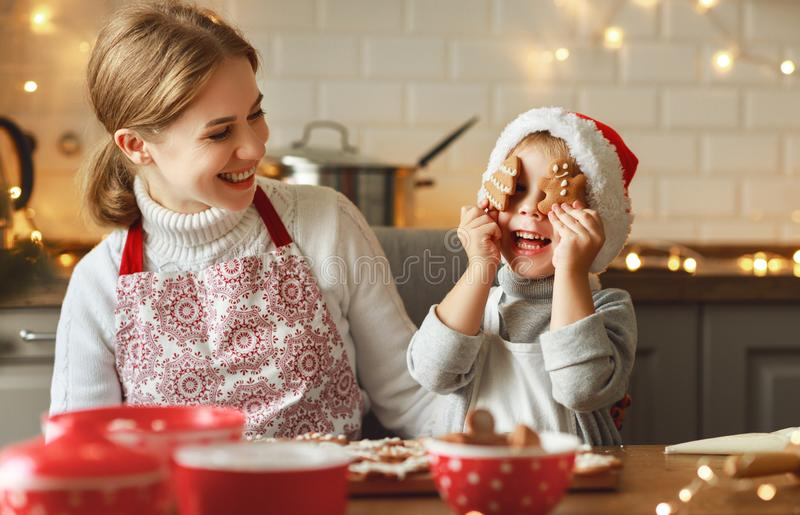 Happy family mother and child bake christmas cookies royalty free stock photos