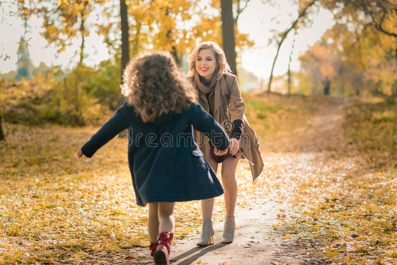 Happy family mother and child daughter on autumn walk stock image