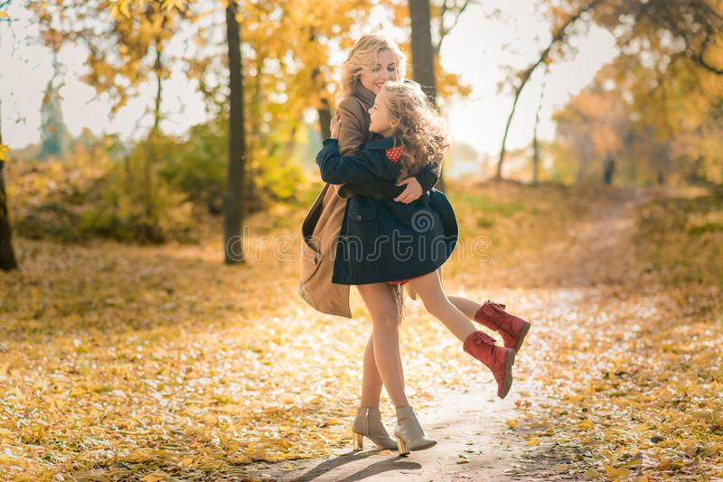 Happy family mother and child daughter on autumn walk stock photo