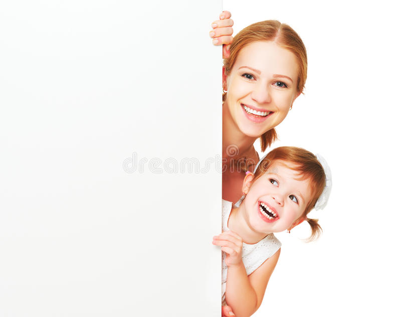 Happy family mother child daughter with blank white poster. Isolated stock photography