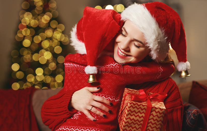 Happy family mother and child daughter giving christmas gift stock photos