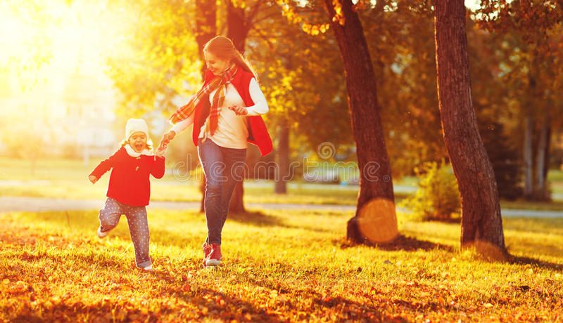 Happy family mother and child little daughter on autumn walk royalty free stock photo