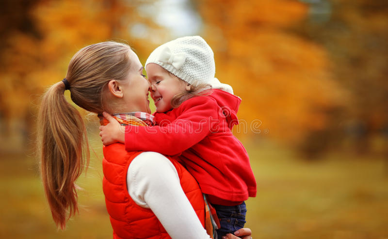Happy family. mother and child little daughter play kissing on a royalty free stock photo