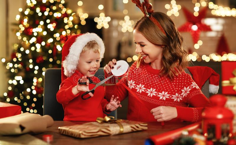 . happy family mother and child pack Christmas gifts royalty free stock photos