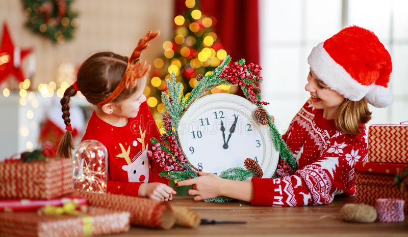 Happy family mother and child pack Christmas gifts at home near Christmas tree stock photos