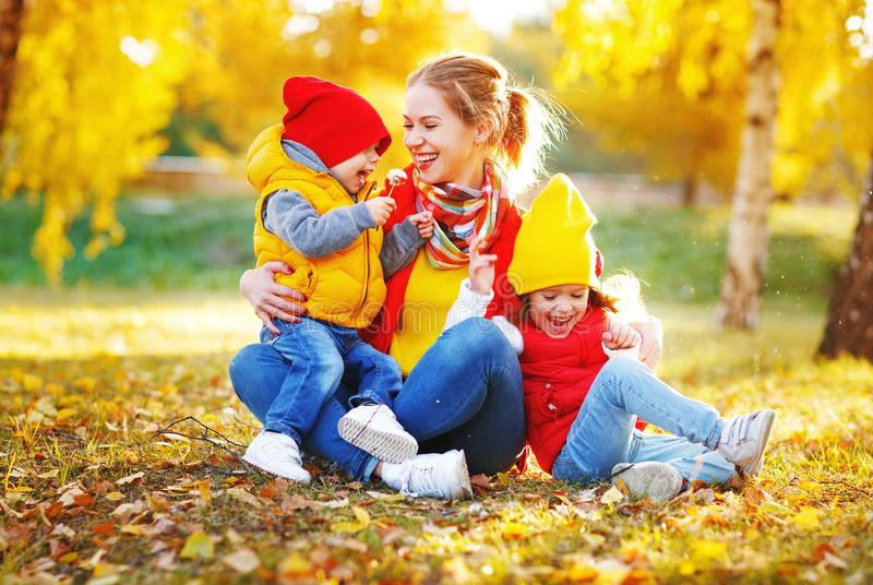 Happy family mother and children on autumn walk. In park stock photography