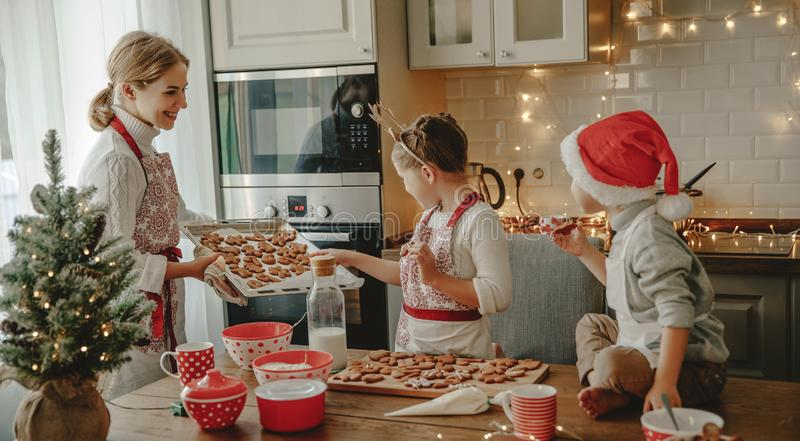 Happy family mother and children bake christmas cookies stock image