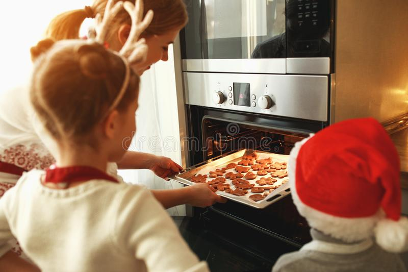 Happy family mother and children bake christmas cookies royalty free stock image