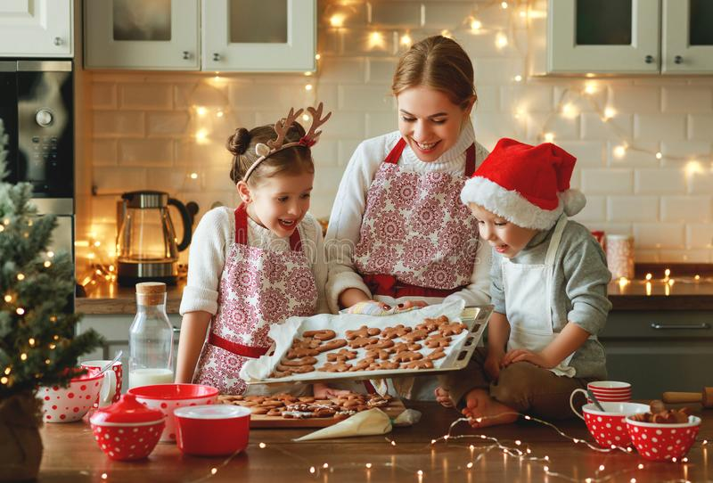 Happy family mother and children bake christmas cookies royalty free stock photo
