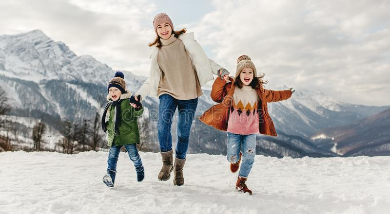 Happy family mother and children having fun on winter walk royalty free stock photos