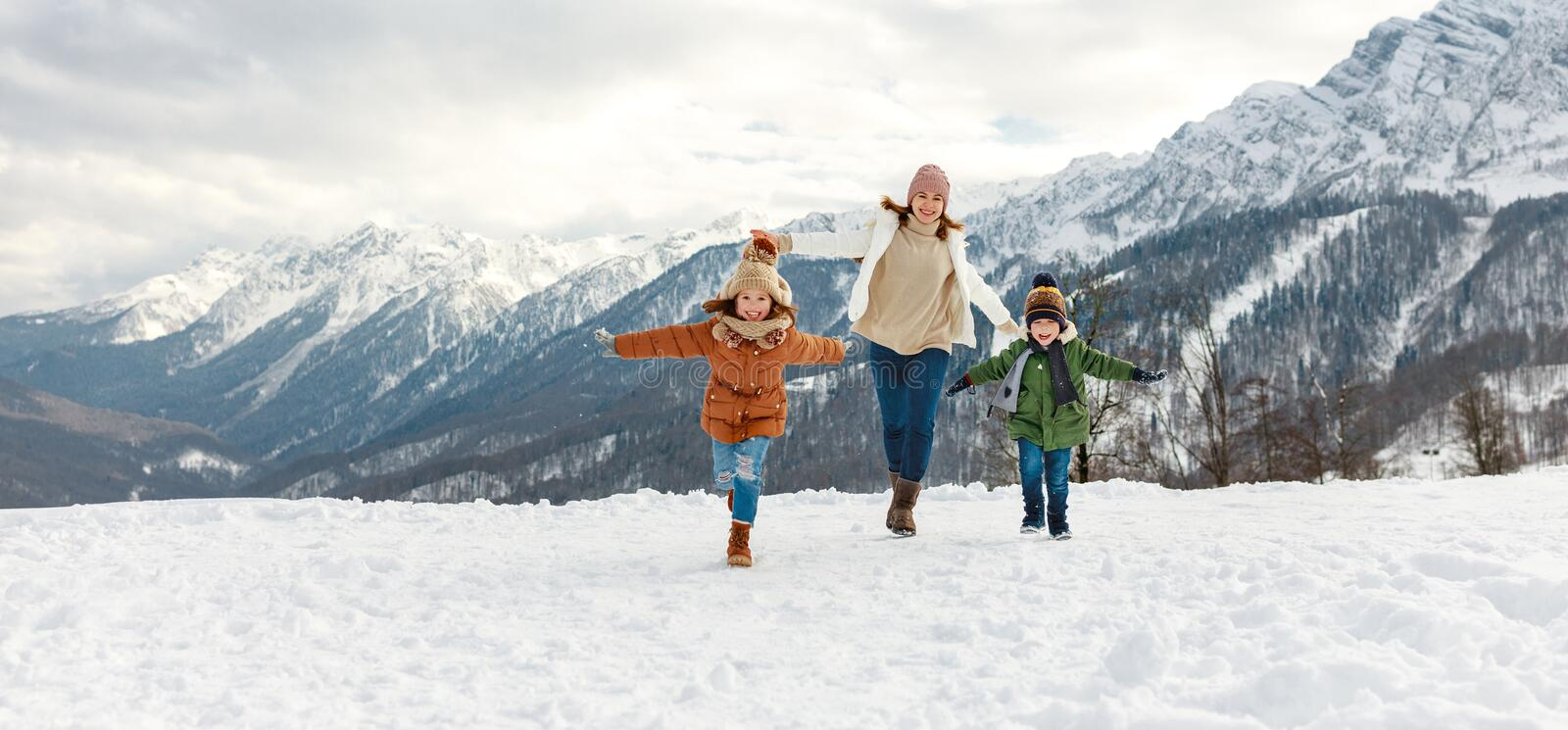 Happy family mother and children having fun on winter walk royalty free stock photo